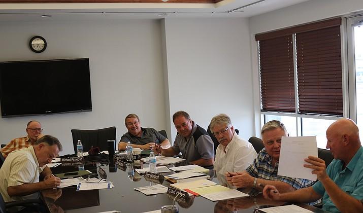 (From left) The Airport Advisory Commission consists of Scott Brackett, Michael Finnegan, David Amspoker, John Stutzman, Tim Gerlach, Carl Hays and Gary Rucker. (Photo by Travis Rains/Daily Miner)