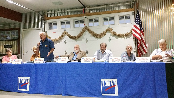 Dewey-Humboldt council member Doug Treadway, running for one of three council seats, answers a question at the Candidate Forum, Aug. 9, at the Cherry Ranch Event Center in Dewey. From left are: Nancy Wright (council), Victoria Wendt (mayor), Treadway, Terry Nolan (mayor), Mark McBrady (council), Lynn Collins (council), and Karen Brooks (council). (Sue Tone/Courier)
