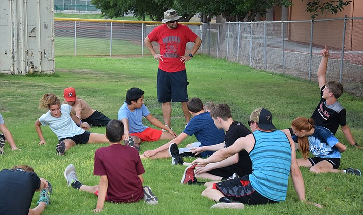 New Mingus head cross country coach Dave Moncibaez talks to runners during stretches on Thursday afternoon at MUHS. VVN/James Kelley