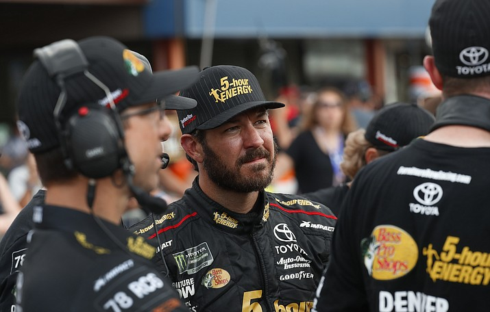 Martin Truex Jr. watches times during qualifications for a NASCAR Cup Series auto race at Michigan International Speedway in Brooklyn, Michigan, Friday, Aug. 10, 2018. (Paul Sancya/AP Photo)