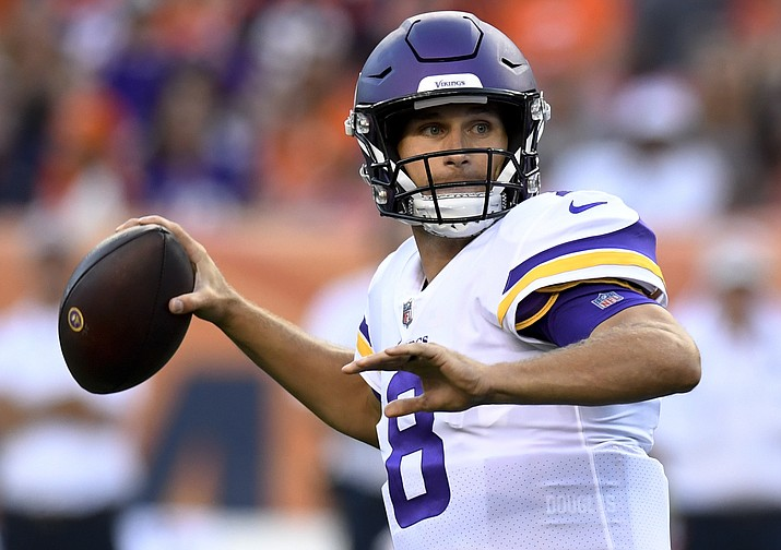 Minnesota Vikings quarterback Kirk Cousins looks to throw a pass against the Denver Broncos during the first half in an NFL preseason football game Saturday, Aug. 11, 2018, in Denver. (Mark Reis/AP Photo)