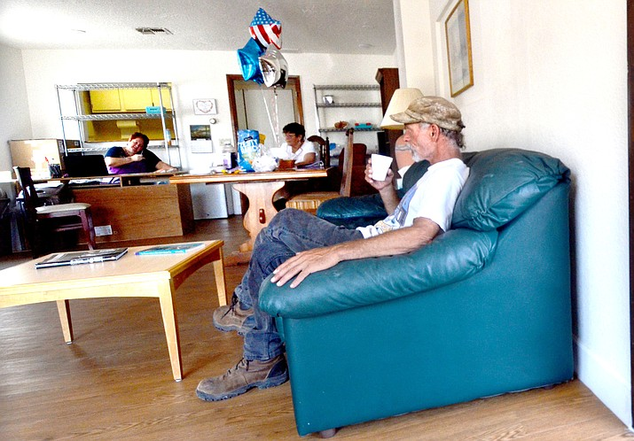 A man sits on a couch at the Verde Valley Homeless Coalition's new drop-in center. VVN/Vyto Starinskas