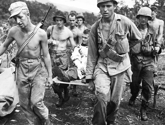 Troops of the 511th Parachute Infantry Regiment, 11th Airborne Division, evacuate a wounded soldier to an aid station at Manarawat on the island of Leyte, December 1944. (Photo by U.S. Army Signal Corps [Public domain], via Wikimedia Commons)