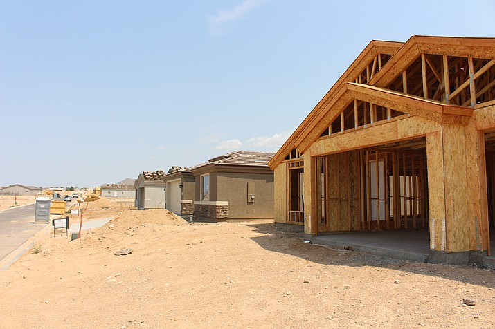 New homes are under construction by Angle Homes in the Hualapai Foothills and Hualapai Shadows subdivisions. While sales have slowed, home prices continue to increase in Kingman and elsewhere in the nation. (Photo by Hubble Ray Smith/Daily Miner)
