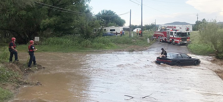 A Central Arizona Fire & Medical Authority (CAFMA) crew rescued a female motorist, whose car was trapped at a river crossing, Sunday evening, Aug. 12. (CAFMA./Courtesy)