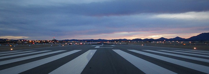 Prescott Municipal Airport runway 21L is shown at dusk in this undated photo. (Courtesy)