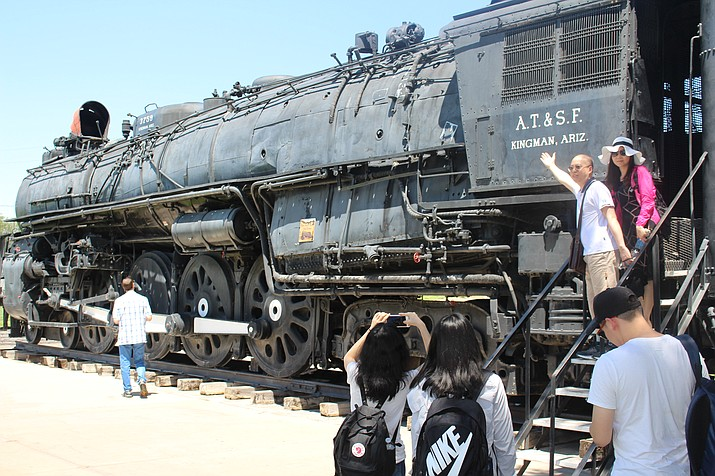 Above, tourists stop for a photo at Locomotive Park. How can space around the Powerhouse Visitor Center be utilized to increase tourism in Kingman? (Hubble Ray Smith/Daily Miner)
