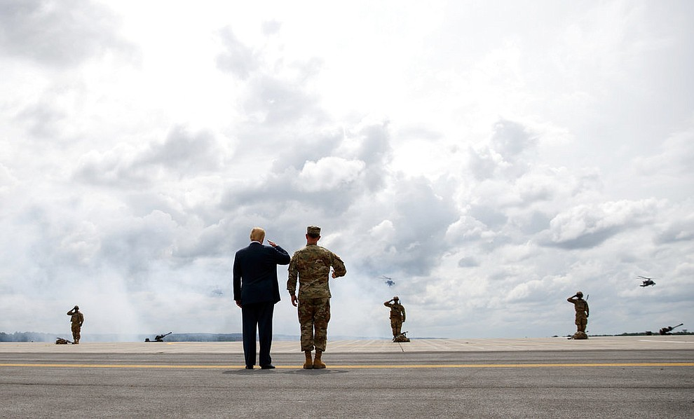 President Donald Trump and Maj. Gen. Walter Piatt view air assault exercises at Fort Drum, N.Y., Monday, Aug. 13, 2018, before a signing ceremony for a $716 billion defense policy bill named for Sen. John McCain. (AP Photo/Carolyn Kaster)