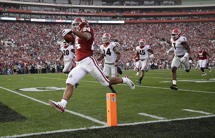 Oklahoma running back Rodney Anderson runs for his second touchdown of the first half of the Rose Bowl NCAA college football game against Georgia in Pasadena, California, Jan. 1, 2018. Anderson didn't even start until mid-season last year, but he finished with 1,442 yards and 18 touchdowns from scrimmage. (Jae C. Hong/AP Photo, file)