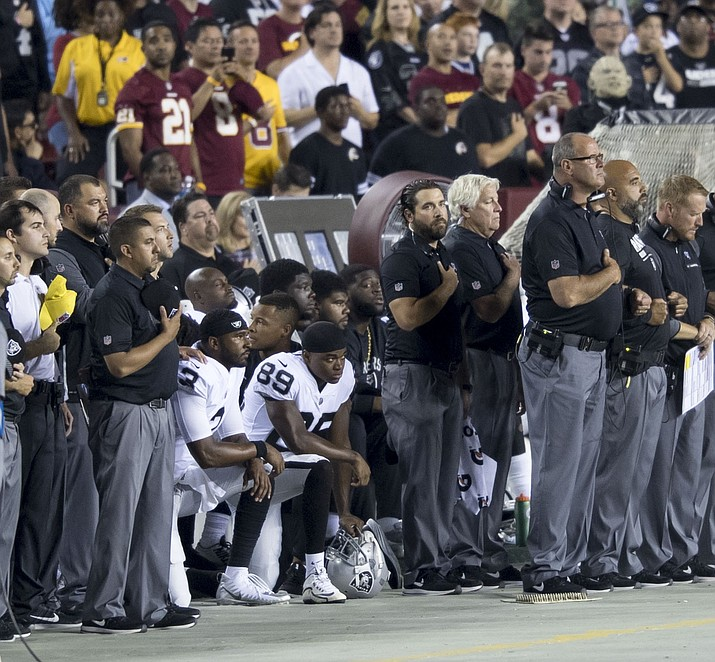 Oakland Raiders kneeling during the national anthem Sept. 24, 2017. Talks are underway between the NFL and the players to resolve the issue. (Photo by Keith Allison, CC 2.0, https://bit.ly/2MHW8B0)