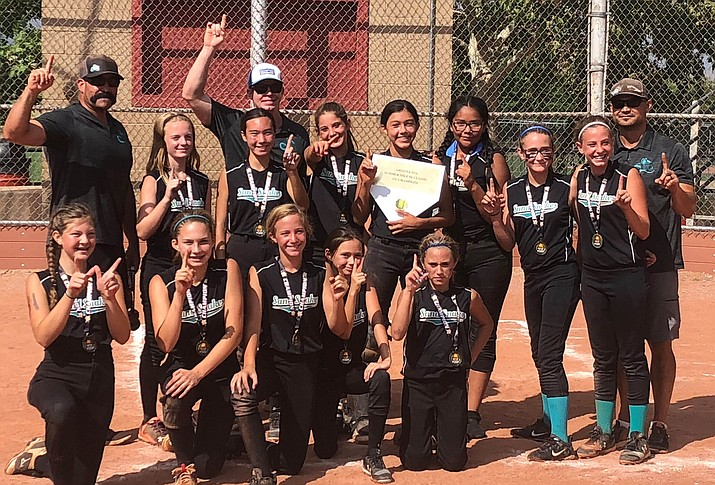 The 12U Prescott Sand Snakes fast-pitch softball team poses for a photo after claiming the Summer Mile Hi Classic championship game, defeating Tucson-based AZ Cats 16-7 on Sunday, Aug. 12, in Prescott. (Jennifer Jacobson/Courtesy)