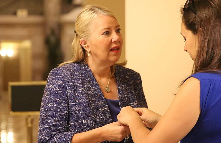 Rep. Debbie Lesko, R-Peoria, prepares for an 8 a.m. interview with OANN in the Capitol, the start of a 12-hour day. Experts say most members of the House report working 70 hours in a typical week, between political and legislative duties. (Photo by Bryan Pietsch/Cronkite News)