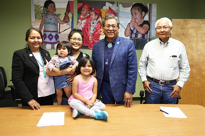 President Russell Begaye with leaders in education and a Navajo Head Start family after he signed $6.3 million for the program. (Office of the President and Vice President)