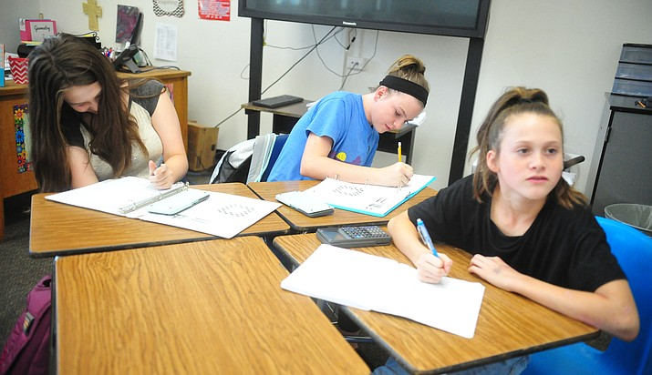 Michaela Campbell, Macy Carr and Sarh Schlosberg work on a problem in Amanda Fagin's Algebra 1 class at Prescott Mile High Middle School Friday, Aug. 10, 2018.  (Les Stukenberg/Tribune)