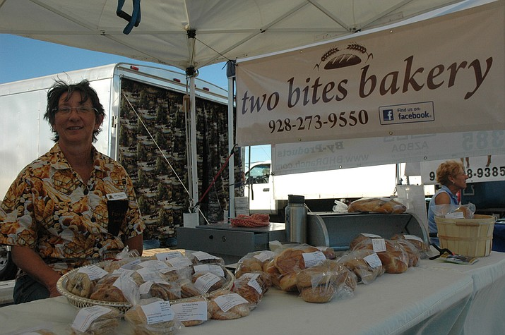 Allee Steinberg of Two Bites Bakery sells at the first Chino Valley Farmers Market of the season at Olsen's Grain Thursday, June 7. The Chino Valley Farmers Market continues every Thursday from 3 to 6 p.m. until Thursday, Oct. 25. (Jason Wheeler/Review)
