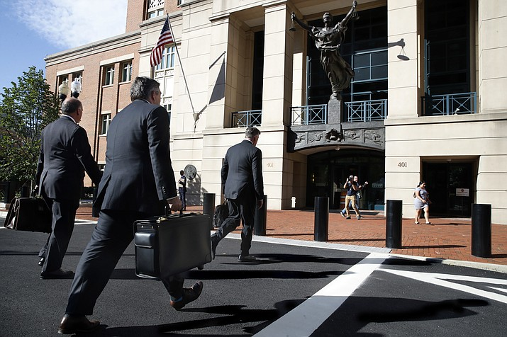 Members of the defense team for Paul Manafort, including Thomas Zehnle, left, Richard Westling, and Kevin Downing, walk to federal court as the trial of the former Trump campaign chairman continues, in Alexandria, Va., Tuesday, Aug. 14, 2018. The focus in Paul Manafort's fraud trial shifts to the defense after prosecutors rested their case. (Jacquelyn Martin/AP Photo)