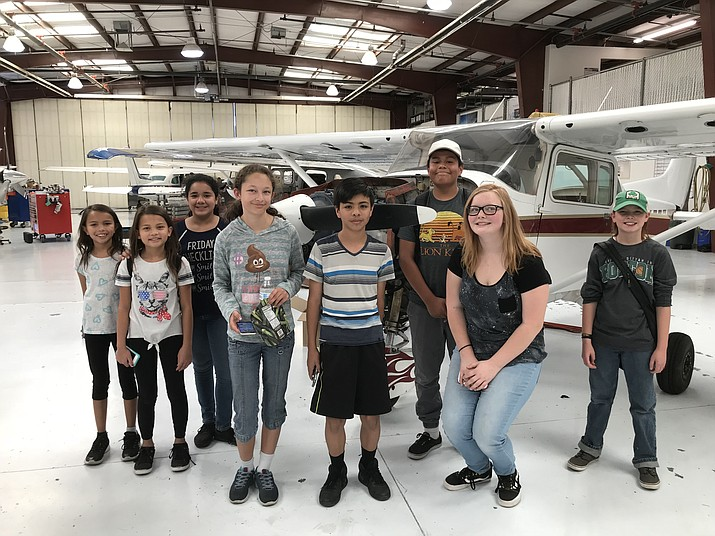Students in the Prescott Valley Schools inaugural STEM Summer Camp visited Legend Aviation's maintenance hangar at the Prescott Airport, one of several field trips, in June. From left are Hailey Runge, Keala Runge, Alondra Salinas, Bailey Gonzales, Lisandro Trujillo, Andy Olofson, Sabyr Turner and Lincoln-Ethan Phoenix. (Courtesy)