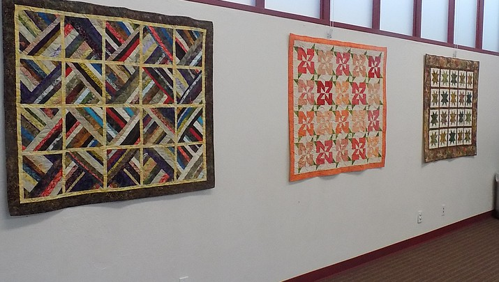 Local quilters  decorate library's  community room