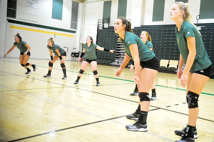 Yavapai College volleyball players Pilar Daugherty (setter), Nynke de Vries (outside hitter), Victoria McCarty (libero), Annie Harte (outside hitter), Makenna Busse, middle blocker, Lexi Cole (right side hitter), await a serve during a drill Thursday, Aug. 9, 2018, in Prescott. (Les Stukenberg/Courier)