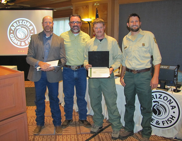 Michael Sedgeman and Travis Largent accept the Arizona Game and Fish Commission award on behalf of the Kaibab National Forest earlier this month. (Photo/Kaibab National Forest)