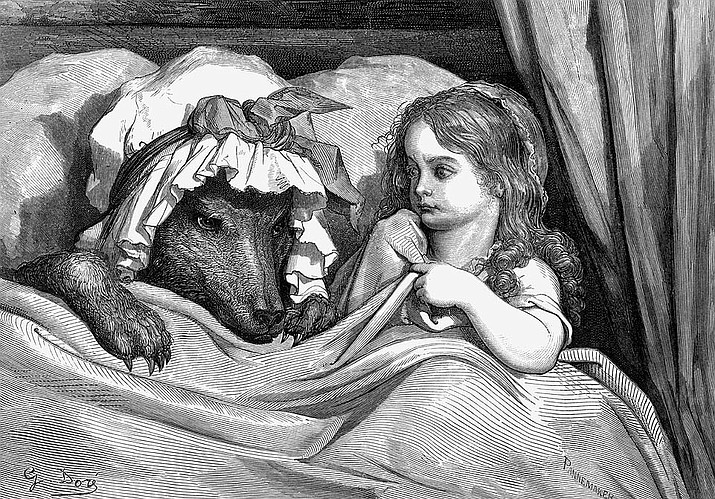 """Gustave Doré's (1883) woodcut engraving of a scene from the European fairy tale Little Red Riding Hood. """"She was astonished to see how her grandmother looked."""""""