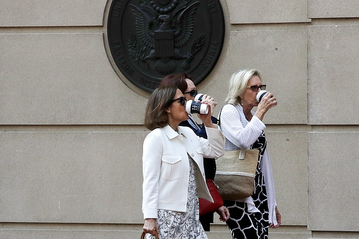 Kathleen Manafort, center, drinks from a coffee cup as she returns to federal court after a break in closing arguments in the trial of her husband, former Trump campaign chairman Paul Manafort, in Alexandria, Va., Wednesday, Aug. 15, 2018. (Jacquelyn Martin/AP Photo)
