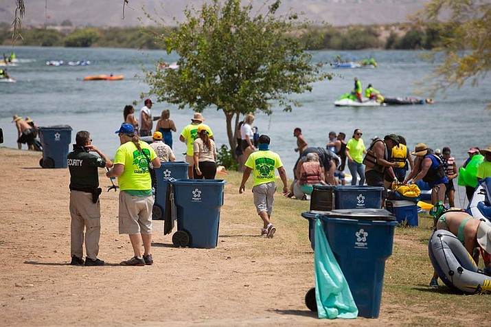Cleanup crews under contract with Marnell Gaming pick up trash at Davis Camp following last weekend's 2018 Laughlin River Regatta. (Photo courtesy Laughlin River Regatta Facebook)