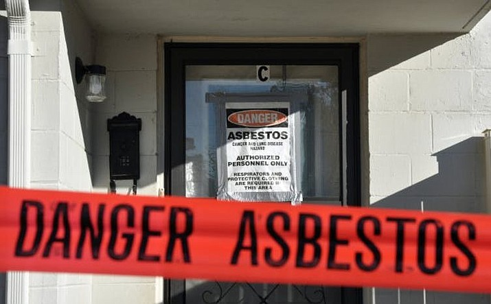 Asbestos was widely used in flooring, walls, ceilings and pipes until the 1980s, when it was shown to cause lung cancer. Today workers removing asbestos from older buildings wear protective clothes and respirators.  (Photo by the U.S. Army)