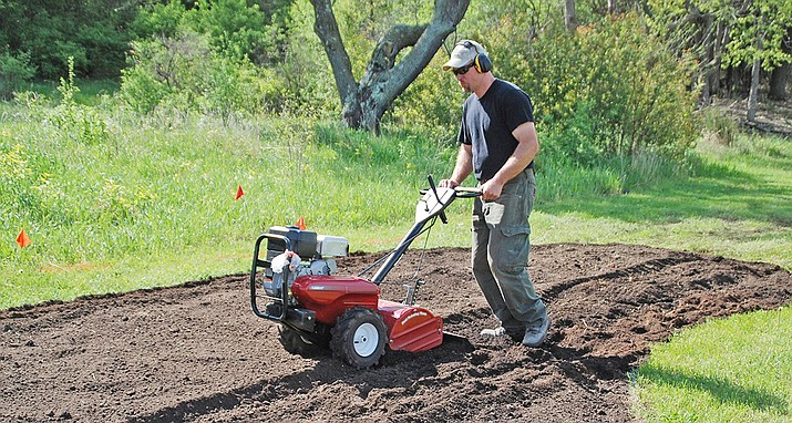 Prior to planting is the easiest time to amend the soil by adding compost, aged manure or other organic matter to planting beds. (Melinda Myers/Courtesy)
