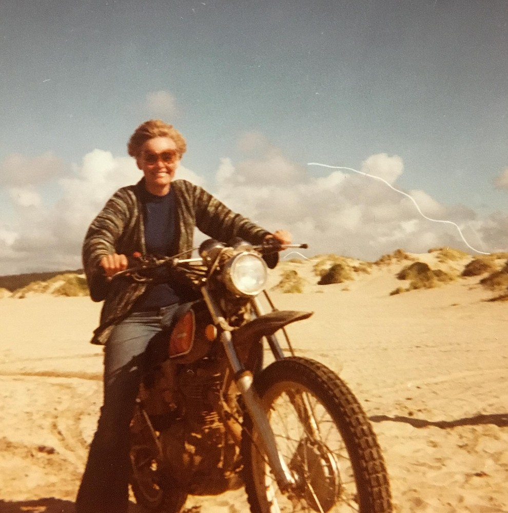 Long-time local politician Carol Springer, who died on Aug. 9, 2018, had an adventurous side, including riding motorcycles, flying airplanes, and world-wide travel, her children say. Here, she rides a motorcycle on a family trip to the Oregon coast in about 1978. (Courtesy/Springer family)