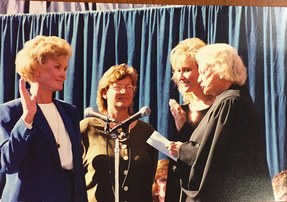 """Long-time local politician Carol Springer, who died Aug. 9, 2018, at age 81, was among the """"Fab Five"""" – a group of Arizona state top office holders who got national attention in 1999 for being exclusively female. Here, Springer, right, is sworn in as Arizona State Treasurer by U.S. Supreme Court Justice Sandra Day O'Connor, left, as Springer's daughters Leslie and Carol Lynn look on. (Couresy/Springer family)"""