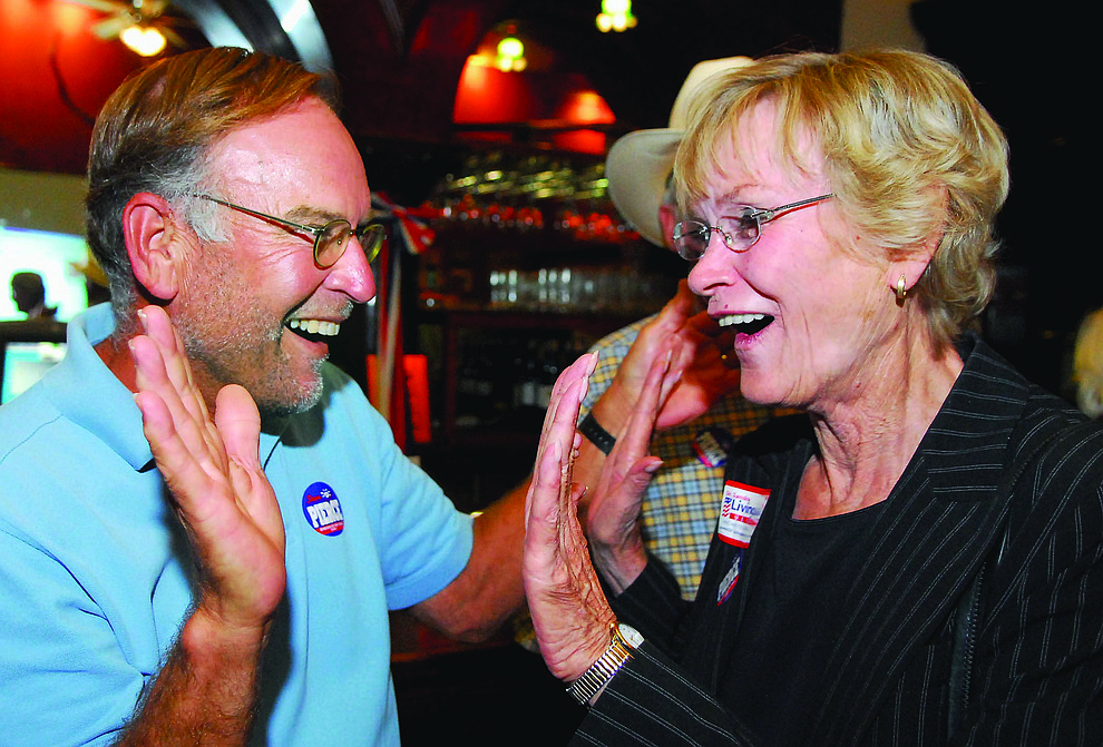 Carol Springer, Board of Supervisors District 1 Republican Candidate celebrates with supporter Bill Feldmeier after election results come in at the Palace Restaurant in downtown Prescott Tuesday September 2, 2008. (Courier file photo)