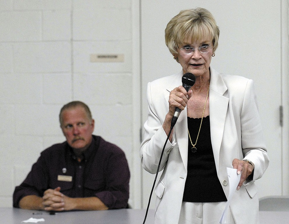 Carol Springer speaks at the debate Tuesday night at the Williamson Valley Fire station #57, with George Seaman October 7, 2008. (Courier file photo)
