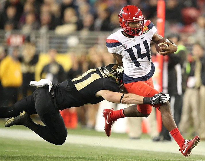 Arizona's Khalil Tate threw for 1,591 yards and added another 1,411 yards on the ground in nine games last season. First-year head coach Kevin Sumlin expects the junior to be more of a passing threat. (Photo courtesy of Stan Liu/Arizona Athletics)