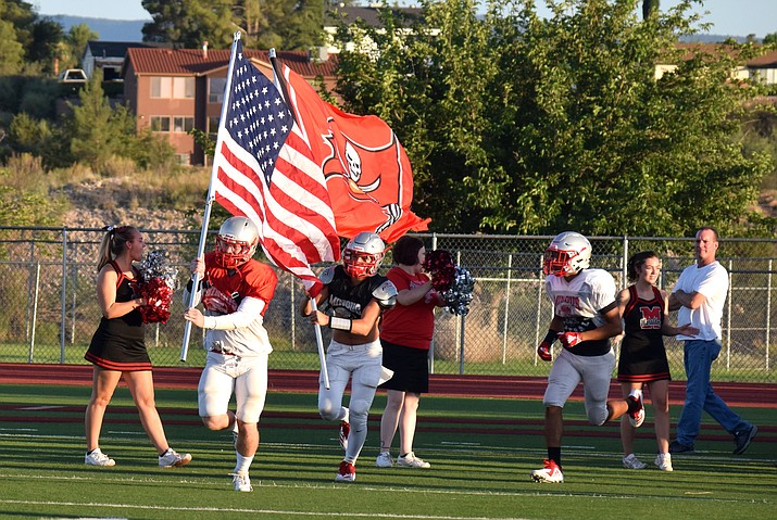 Mingus players run on to the field at the start of the Red and Gray Scrimmage on Aug. 3. VVN/James Kelley
