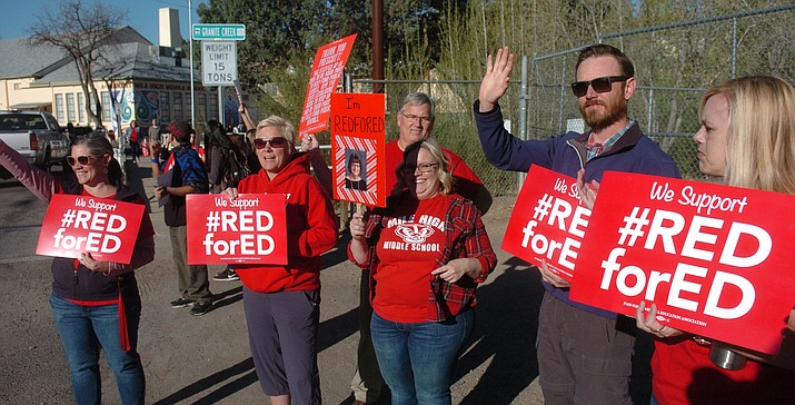 Prescott Mile High Middle School teachers and students welcomed parents as they drop students off as part of the Red for Ed movement in Arizona Wednesday, April 18, 2018. (Les Stukenberg/Courier)