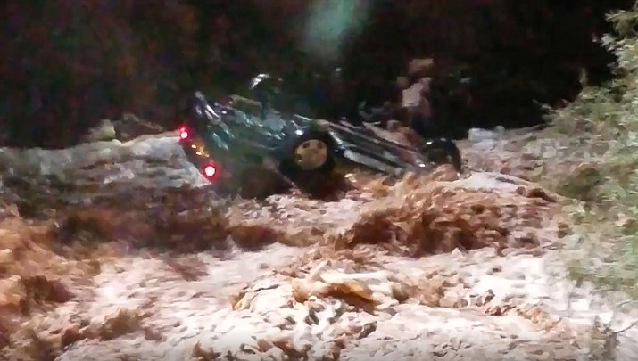 Firefighters in Pima County responded to a report of a vehicle inside down in a wash near Tucson on Sunday, Aug. 12, 2018 around 7:30 p.m. (Rural Metro Fire of Pima County)