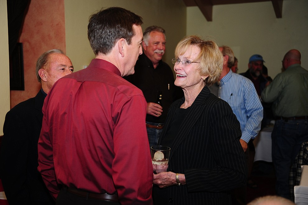 Yavapai County Supervisor Carol Springer shares a laugh with longtime family friend Ken Bennett and Larry Tarkowski at her retirement party at the Prescott Steak House Wednesday December 5, 2012. Attending the party was a who's who of local, county and state officials both elected and supervisory to honor (roast) her. (Les Stukenberg/Courier)
