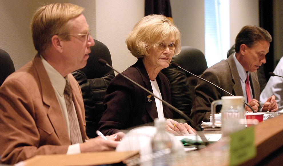 Tom Thurmann, Carol Springer and Chip Davis vote on the consent agenda before they as the Yavapai County Board of Supervisors hold a public hearing Monday, November 7, 2005 on the proposed Pioneer Park county building complex. (Les Stukenberg/Courier)