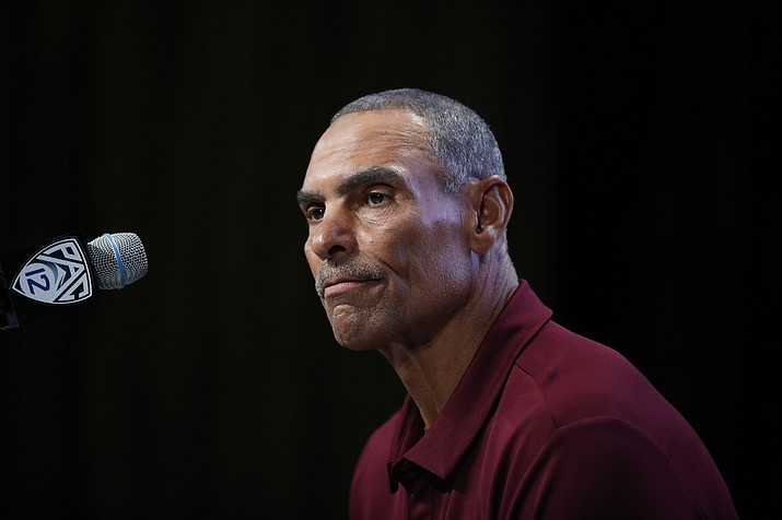 This July 25, 2018, file photo shows Arizona State head coach Herm Edwards pausing while speaking at the Pac-12 Conference Media Day in Los Angeles. (Jae C. Hong/AP, file)