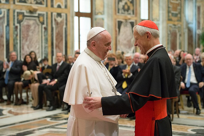 In this Wednesday, Oct. 20, 2010 file photo, Pope Francis, left, talks with Papal Foundation Chairman Cardinal Donald Wuerl, Archbishop of Washinghton, D.C., during a meeting with members of the Papal Foundation at the Vatican. On Tuesday, Aug. 15, 2018, a Pennsylvania grand jury accused Cardinal Wuerl of helping to protect abusive priests when he was Pittsburgh's bishop. (L'Osservatore Romano/Pool Photo via AP)