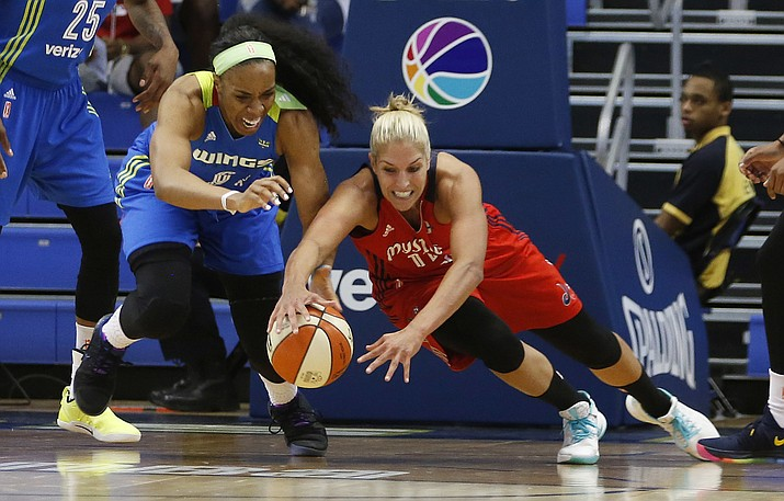 This June 6, 2017, file photo shows Dallas Wings forward Kayla Thornton (6) and Washington Mystics guard Elena Delle Donne (11) diving after a loose ball during the first half of a WNBA basketball game in Arlington, Texas. Delle Donne was named AP Player of the Week  for Aug. 6-12,  after averaging 27.7 points, 5.7 rebounds, 2.3 assists to help Washington go 3-0 this week. (Vernon Bryant/The Dallas Morning News via AP, file)