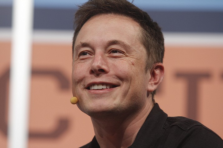 """In this March 9, 2013, file photo, Electric car maker Tesla's CEO Elon Musk gives the opening keynote at the SXSW Interactive Festival in Austin, Texas. Musk has admitted in a wide-ranging interview with The New York Times that stress is taking a heavy toll in what he calls an """"excruciating year."""" In the newspaper's account of the interview, published Friday, Musk said he was working up to 120 hours a week and sometimes takes Ambien to get to sleep. (Jack Plunkett/AP, File)"""