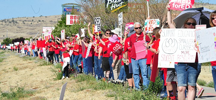 Humboldt Unified School District teachers gather along Highway 69 in Prescott Valley as teachers across Arizona stage a walk out, forcing school closures, seeking more pay and restored funding for education Thursday, April 26, 2018. (Les Stukenberg/Courier, file)