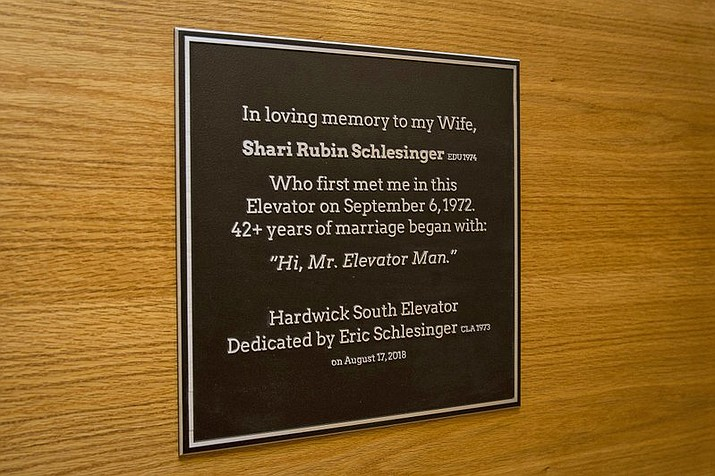 "This Wednesday, Aug. 15, 2018, photo provided by Temple University shows a plaque commemorating a 45-year relationship that began when Sharyn Rubin first met Eric Schlesinger as he held open elevator doors in a dorm for her during move-in day on Sept. 6, 1972, with the plaque installed outside the elevator where they met at the university in Philadelphia. Rubin introduced herself days later at a college mixer by walking up to Schlesinger and saying, ""Hi, Mr. Elevator Man."" She died last year from colon cancer. The quote is now affixed to the elevator, which will be named for Shari Rubin Schlesinger on Friday. (Joseph V. Labolito/Temple University via AP)"