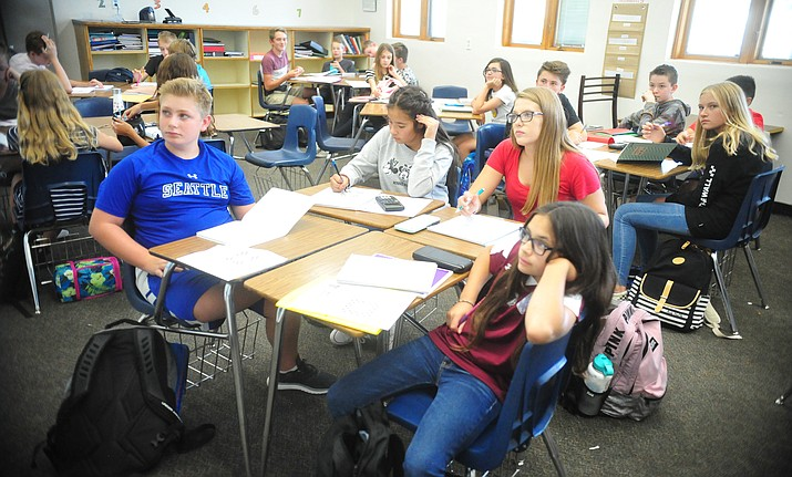 Students in Amanda Fagin's Algebra 1 class at Prescott Mile High Middle School look at a problem on the white board Friday, Aug. 10, 2018.  (Les Stukenberg/Courier)
