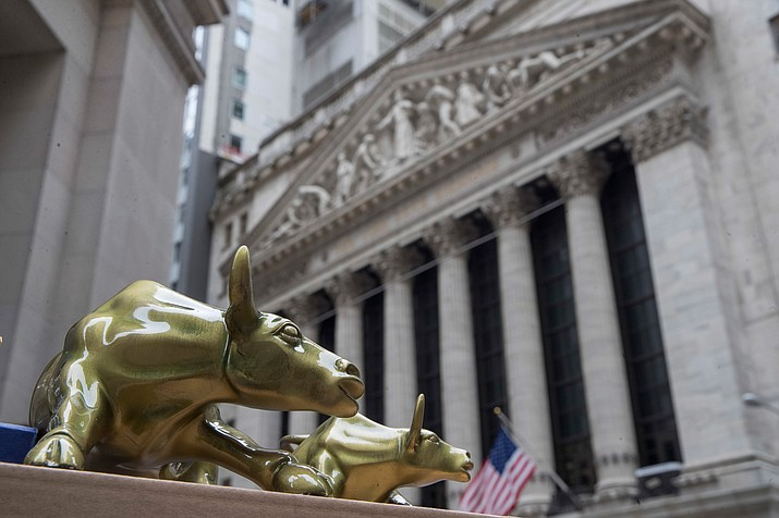 "In this April 24, 2018, file photo replicas of Arturo Di Modica's ""Charging Bull"" are for sale on a street vendor's table outside the New York Stock Exchange in New York. The U.S. stock market opens at 9:30 a.m. EDT on Friday, Aug 17. (Mary Altaffer/AP, File)"