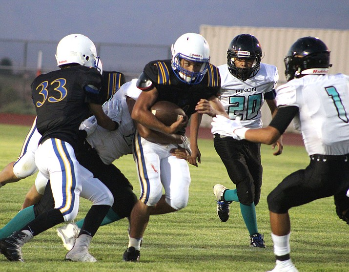 Kingman's Austin Dias ran for 205 yards and three touchdowns Friday night against Pinon. Dias also threw for 180 yards and four touchdowns to lead the Bulldogs to a win in their season opener.  (Photo by Beau Bearden/Daily Miner)