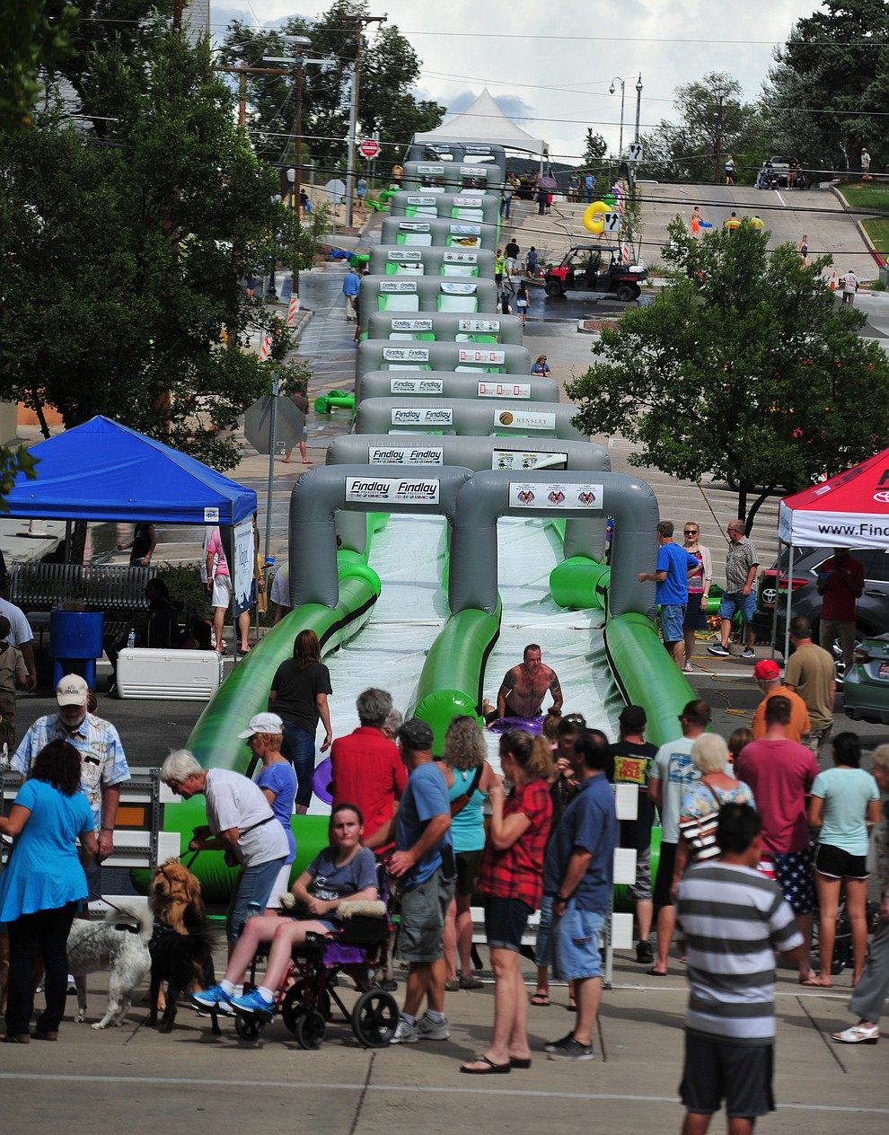 The big fearture is the 600+ foot water slide at the Monsoon Festival in downtown Prescott Saturday, August 18, 2018.  (Les Stukenberg/Courier)
