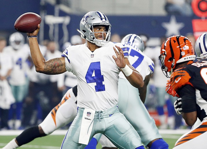 Dallas Cowboys quarterback Dak Prescott (4) looks to throw against the Cincinnati Bengals during the first half of a preseason NFL Football game in Arlington, Texas, Saturday, Aug. 18, 2018. (Michael Ainsworth/AP)